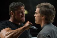 Gerard Butler as Kable and Michael C. Hall as Ken Castle in