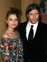 Lauren German and Crispin Glover at the premiere of