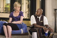 Amy Poehler and Romany Malco in