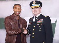 Michael B. Jordan and Lt. Colonel Rich Davis at the Salute To The Tuskegee Airmen on Veteran's Day Weekend during the New York Jets Vs. New England Patriots Game in New Jersey.