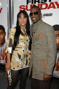 Candice Hood and Rickey Smiley at the premiere of