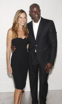 Djimon Hounsou and Hilary Swank at the 25th Anniversary Party of Calvin Klein Underwear.