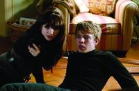 Emily Meade as Fang and Max Thieriot as bug in