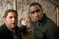 Jonah Hill as Aaron and Sean Combs as Sergio Roma in