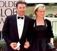 Kim Basinger and her husband Alec Baldwin at the 55th Annual Golden Globe Awards at the Beverly Hilton.
