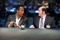 Dwayne Johnson as Agent 23 and David Koechner as Agent Larabee in