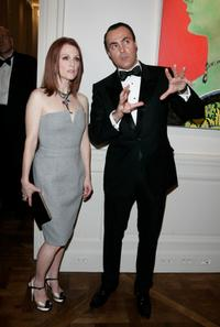 Julianne Moore and Jean Christophe Bedos at the cocktail reception for the 150th Anniversary dinner of Boucheron.