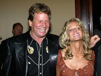 Ryan O'Neal and Farrah Fawcett at the Share Inc. 51st Annual Boomtown Party.