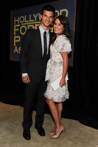 Taylor Lautner and Lea Michele at the Hollywood Foreign Press Association's 2011 Installation Luncheon in California.