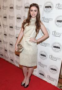 Lily Collins at the 17th Annual Multicultural Motion Picture Association student filmmaker Oscar luncheon.