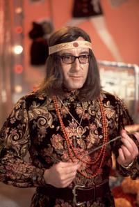 Peter Sellers in some psychedelic clothes.