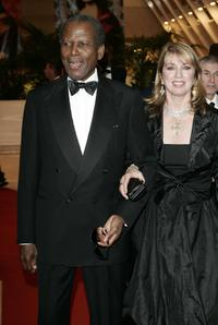 Sidney Poitier and Joanna Shimkus at the Opening Ceremony dinner during the 59th International Cannes Film Festival.