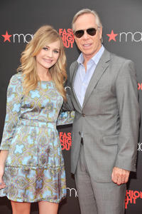 Britt Robertson and designer Tommy Hilfiger at the Fashion's Night Out at Macy's Herald Square in New York.