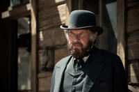 Tom Wilkinson as Latham Cole in