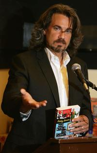 Robby Benson talking to an audience and signing copies of his new book
