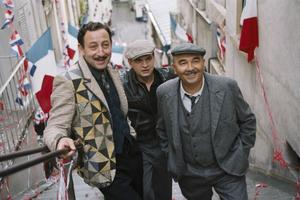 "Kad Merad as Jacky, Clovis Cornillac as Milou and Gerard Jugnot as Pigoil in ""Paris 36."""