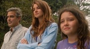 "George Clooney as Matt King, Shailene Woodley as Alexandra and Amara Miller as Scottie in ""The Descendants."""