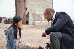 "Catherine Chan as Mei and Jason Statham as Luke Wright in ""Safe."""