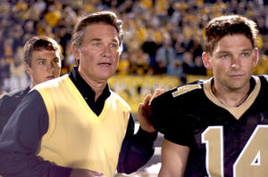 "Kurt Russell as Coach Hand and Brian Presley as Scott Murphy in ""Touchback."""
