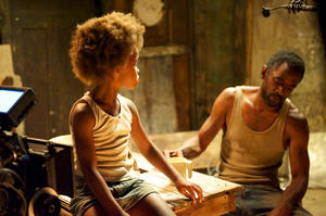 "Quvenzhane Wallis as Hushpuppy and Dwight Henry as Wink in ""Beasts of the Southern Wild."""
