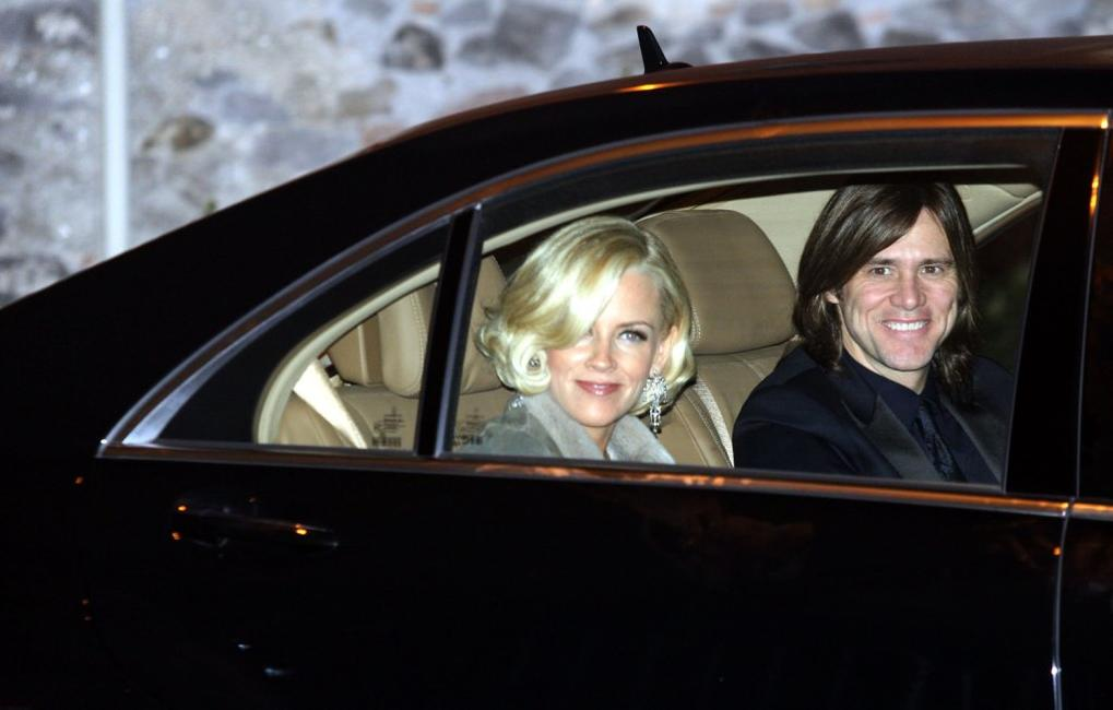 Jim Carrey and Jenny McCarthy at the wedding of Katie Holmes and Tom Cruise.