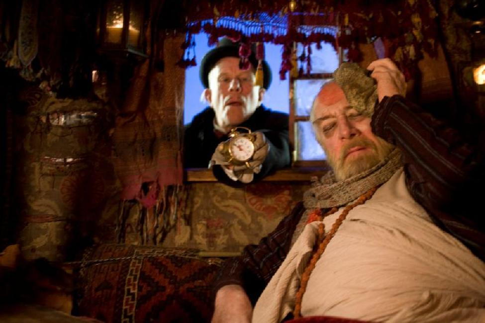 Tom Waits as Mr. Nick and Christopher Plummer as Dr. Parnassus in
