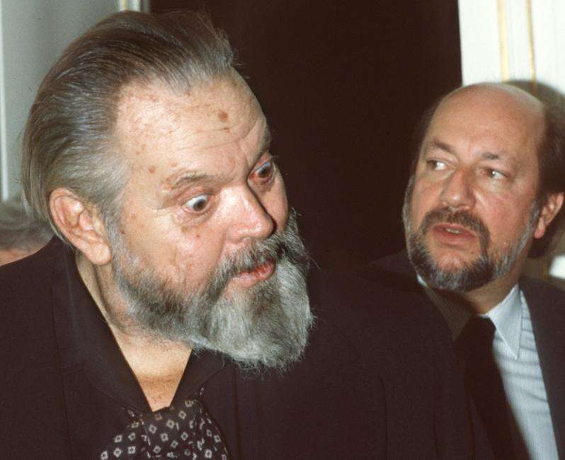 American film actor and director Orson Welles chats with French TV chairman Yvon Bourges about French Government participation in the budget of his next film