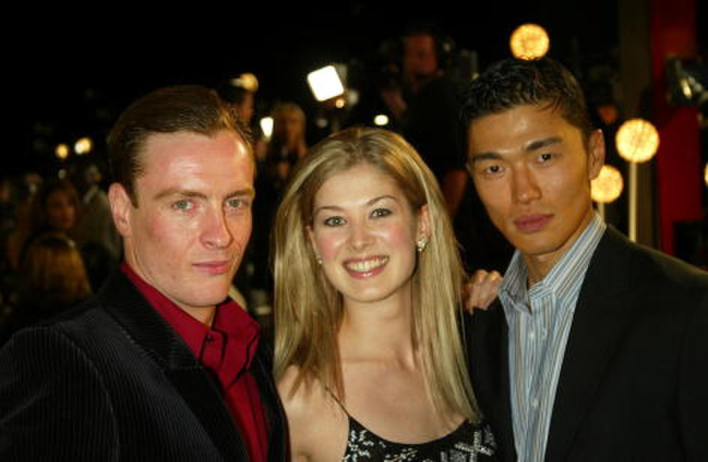 Toby Stephens, Rosamund Pike and Rick Yune at the premiere of