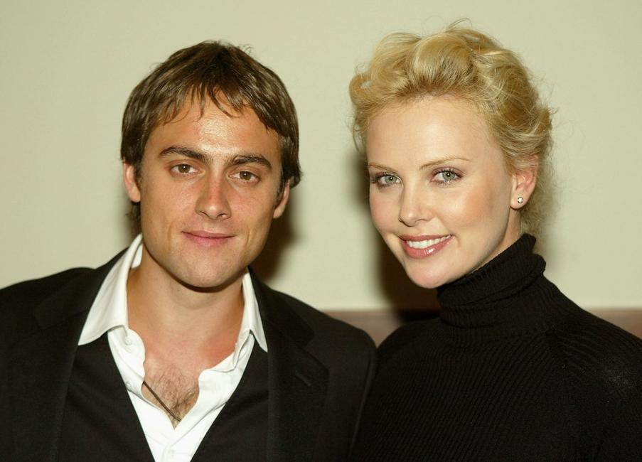 Stuart Townsend and his girlfriend Charlize Theron at the after-party of