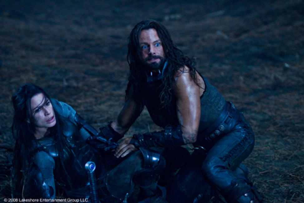Rhona Mitra as Sonja and Michael Sheen as Lucian in