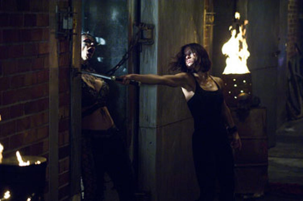 Eden Sinclair (Rhona Mitra) holds vicious marauder Viper (Leanne Liebenberg) at knifepoint in