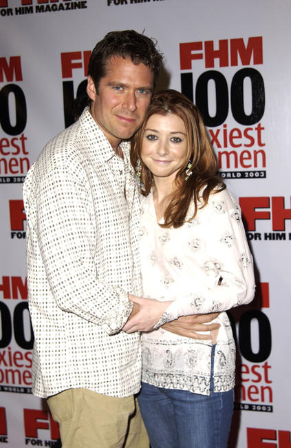 Alexis Denisof and Alyson Hannigan at the FHM's