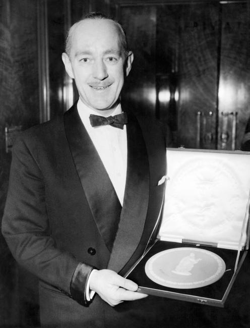 Alec Guinness and his British Film Academy Award.