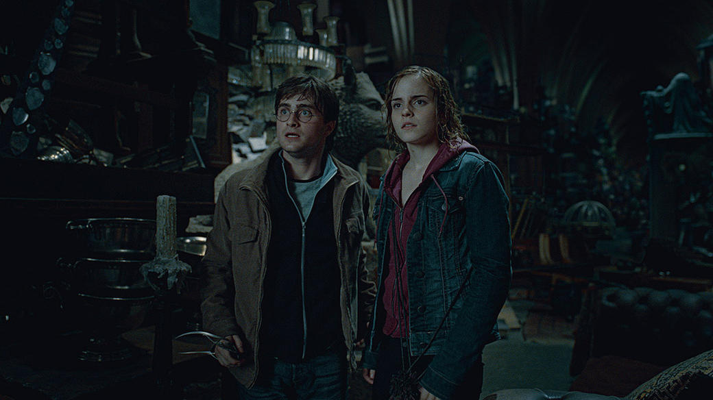 Daniel Radcliffe as Harry Potter and Emma Watson as Hermione Granger in