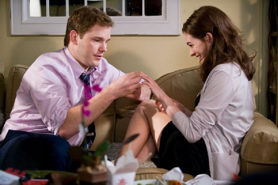 Chris Pratt as Fletcher and Anne Hathaway as Emma in