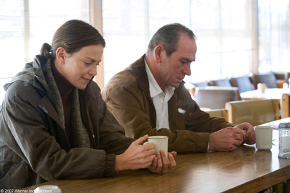 Charlize Theron and Tommy Lee Jones in