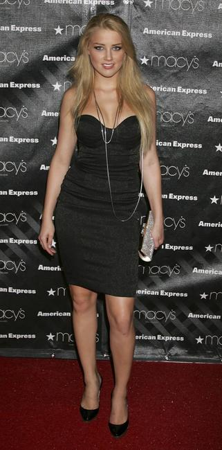 Amber Heard at the Macys Passport auction and fashion show in celebration of it's 25th anniversary.