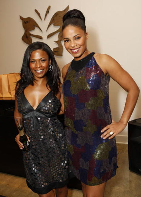 Nia Long and actress Sanaa Lathan at the boutique launch and holiday shopping event.
