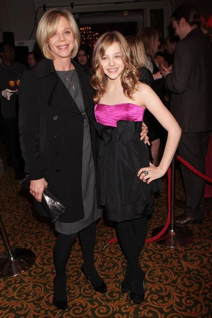 Chloe Grace Moretz and Guest at the Jameson Empire Film Awards 2010.