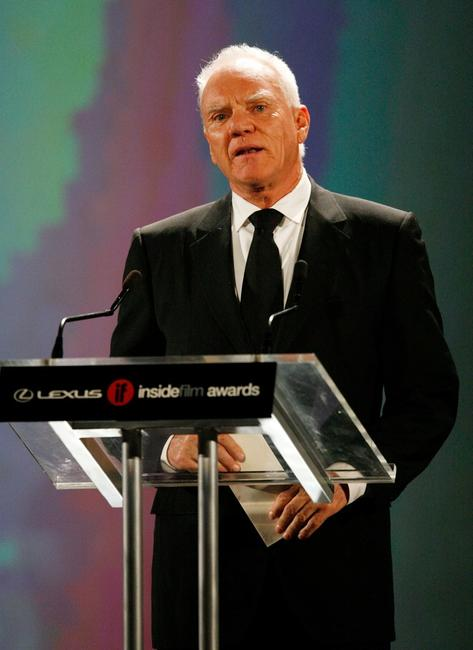 Malcolm McDowell presents an award during the 2005 Lexus Inside Film Awards.