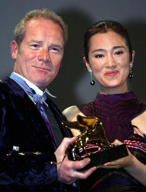 Peter Mullan and Gong Li at the closing ceremony of the 59th Venice Film Festival.
