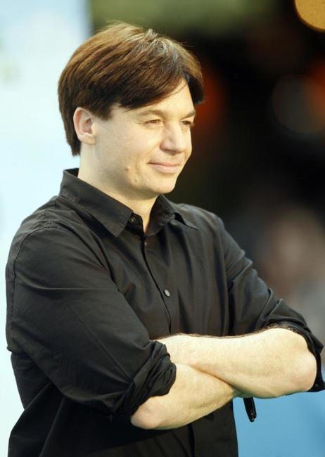 Mike Myers poses for photographers on the