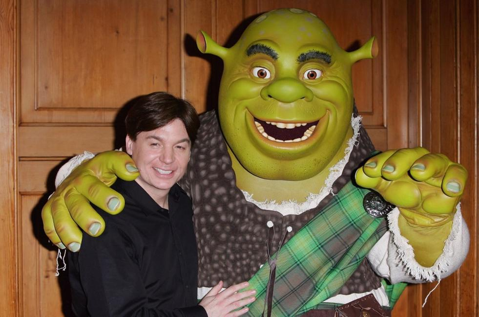 Mike Myers poses alongside Shrek after Shrek received official Scottish clan tartan.