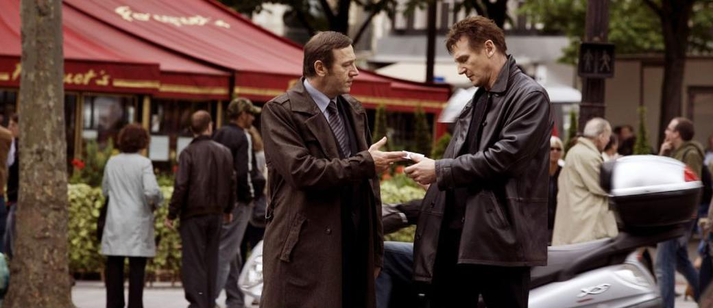 Liam Neeson as Bryan Mills and Olivier Rabourdin as Jean Claude in