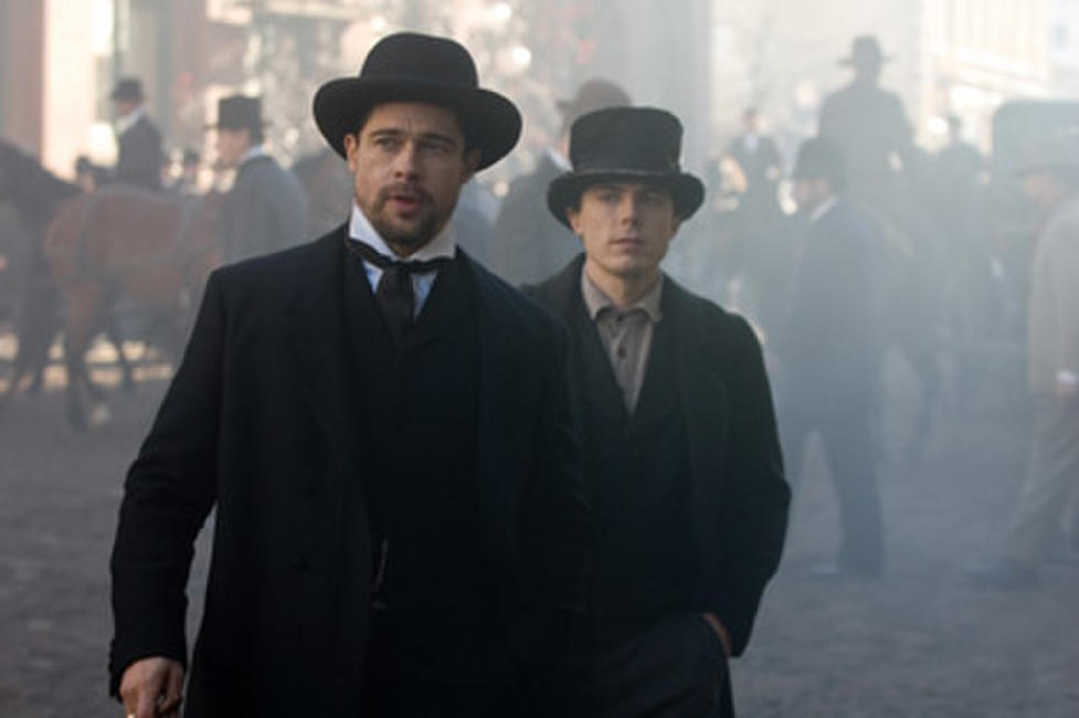 Brad Pitt as Jesse James and Casey Affleck as Robert Ford in