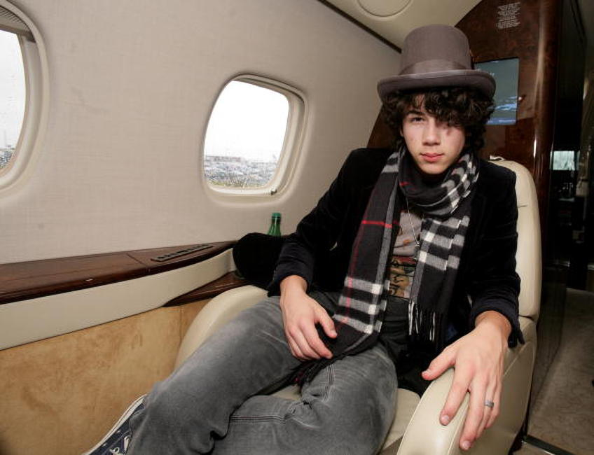 Nick Jonas at the Embraer RJ135 private jet in UK.