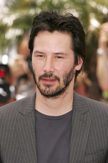 Keanu Reeves at a photocall promoting the film A Scanner Darkly at the Palais des Festivals at 59th International Cannes Film Festival.