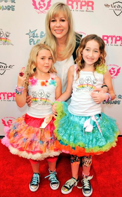 Emily Grace Reaves, Daphna Ziman and Noah Cyrus at the launch of Lollipops and Rainbows Foundation.
