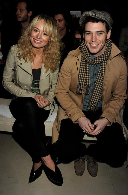 Laura Haddock and Sam Claflin at the Burberry Prorsum Show during the London Fashion Week Autumn/Winter 2011.