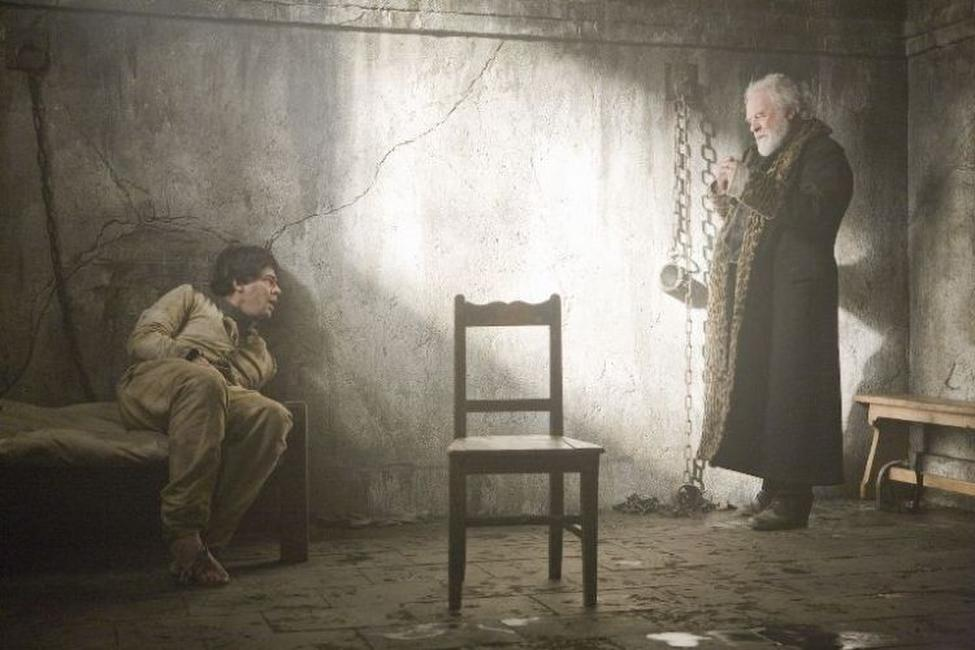 Benicio Del Toro as Lawrence Talbot and Anthony Hopkins as Sir John Talbot in